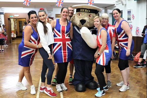 A group of CheeziFitters meet Hero Bear