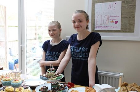 Sisters Olivia and Amelia Bake for Heroes